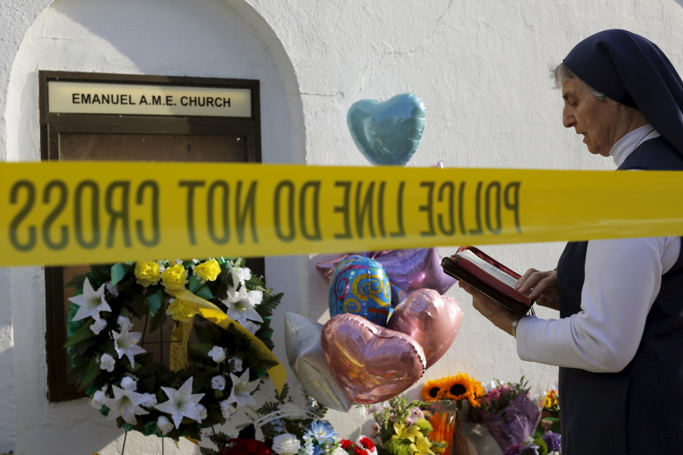 Sister Mary Thecla  prays outside the Emanuel African Methodist Episcopal Church in Charleston, South Carolina on June 19, 2015, two days after a mass shooting at the church left nine dead. (Reuters)