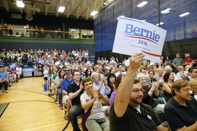 A supporter holds a sign during town hall meeting for Democratic presidential candidate, Sen. Bernie Sanders, I-Vt., at Nashua Community College in Nashua, N.H. on June 27, 2015. (AP)