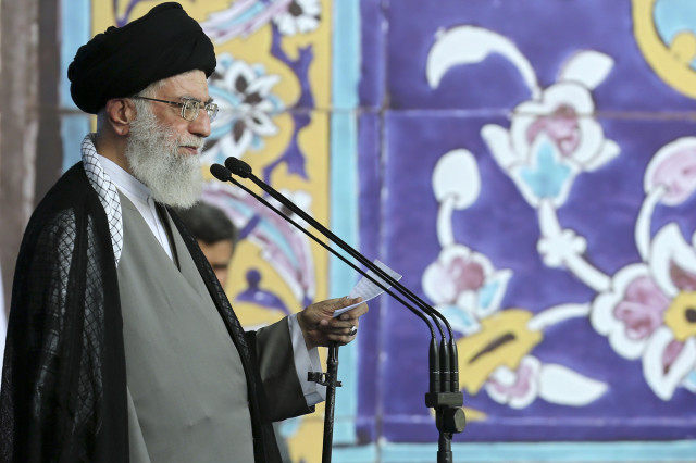 "In this picture released by an official website of the office of the Iranian supreme leader on Saturday, July 18, 2015, Supreme Leader Ayatollah Ali Khamenei delivers his sermon during the Eid al-Fitr prayer at the Imam Khomeini Grand Mosque in Tehran, Iran. Khamenei said a historic nuclear deal with world powers reached this week won't change Iran's policy towards the ""arrogant"" government of the United States. (Office of the Iranian Supreme Leader via AP)"