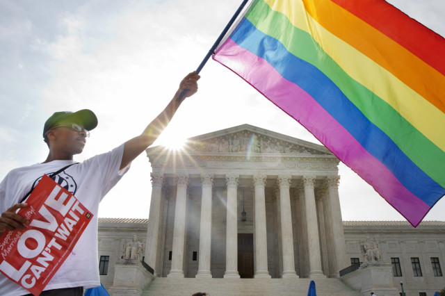 Carlos McKnight waves a flag in support of gay marriage outside the Supreme Court in Washington on June 26, 2015. (AP)