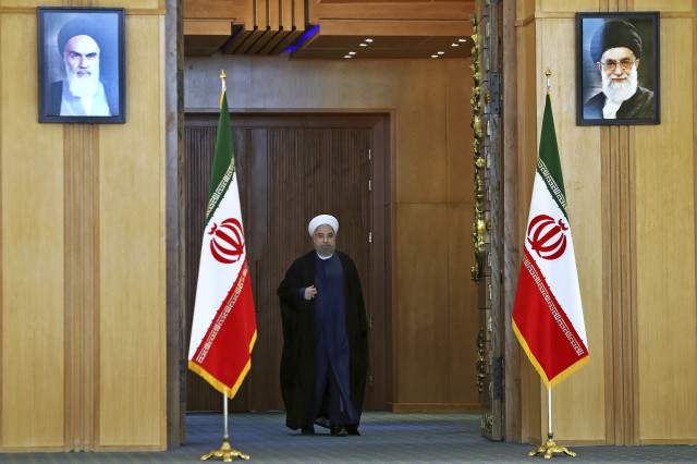 Iran's president Hassan Rouhani arrives for an address to the nation after a nuclear agreement was announced. Tehran, Iran, July 14, 2015 (AP)
