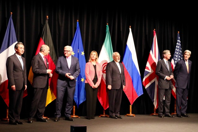 Delegation leaders from P5+1 nations, the EU and Iran assemble to announce deal to limit Iran's nuclear weapons program in Vienna July 14. From left, China's Foreign Minister Wang Yi, France's Foreign Minister Laurent Fabius, Germany's Foreign Minsiter Frank-Walter Steinmeier, EU High Representative for Foreign Affairs Federica Mogherini, Iran's Foreign Minister Javad Zarif, UK Foreign Minister Philip Hammond, U.S. Secretary of State John Kerry. (VOA/Brian Allen)