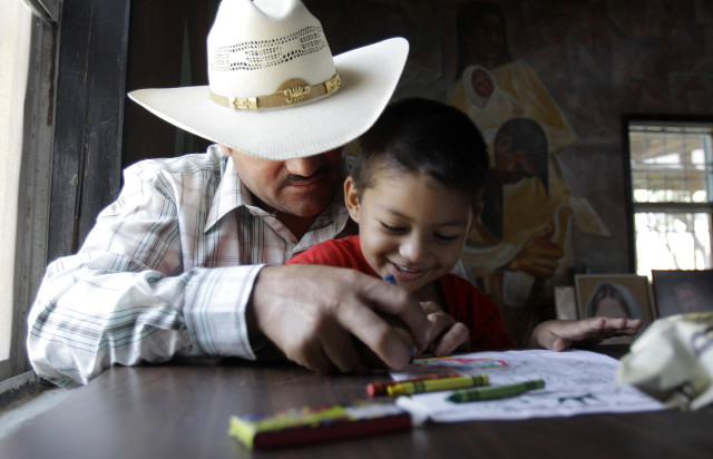 Miguel, 3, plays with his father, Miguel, an illegal immigrant on Aug. 27, 2010, in San Juan, Texas. (AP)