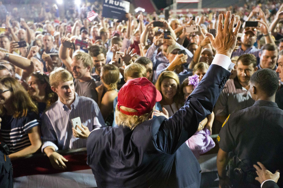 Republican presidential candidate Donald Trump waves to the crowd during a campaign rally on Aug. 21, 2015 in Mobile, Ala. (AP)