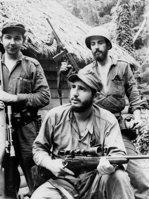 Castro, the young anti-Batista guerilla leader, center, is pictured with his brother Raul Castro, left, and another revolutionary, right, in the mountains of eastern Cuba in 1957.   (AP)