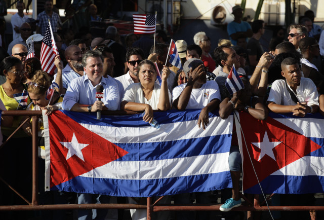 People wait  behind barriers to catch a glimpse of the flag raising ceremony near  the U. S.  Embassy in Havana, Cuba on Aug. 14, 2015.  (AP)