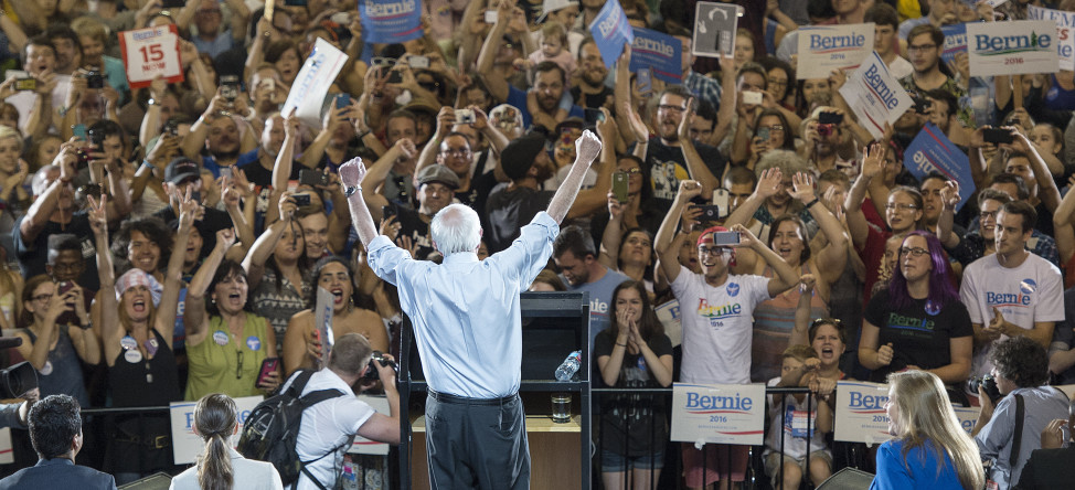 Democratic presidential candidate Sen. Bernie Sanders, I-Vt., lifts his arms in celebration as he speaks at a rally in Portland, Oregon on Aug. 9, 2015. (AP)