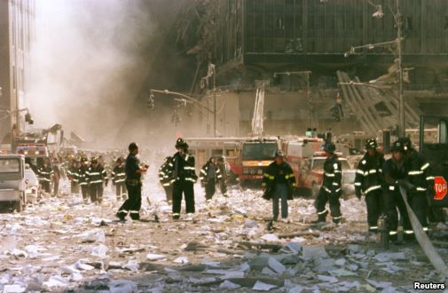 New York City firefighters and other emergency personnel survey the World Trade Center collapse area near Vessey and Greenwich Streets. (Reuters)