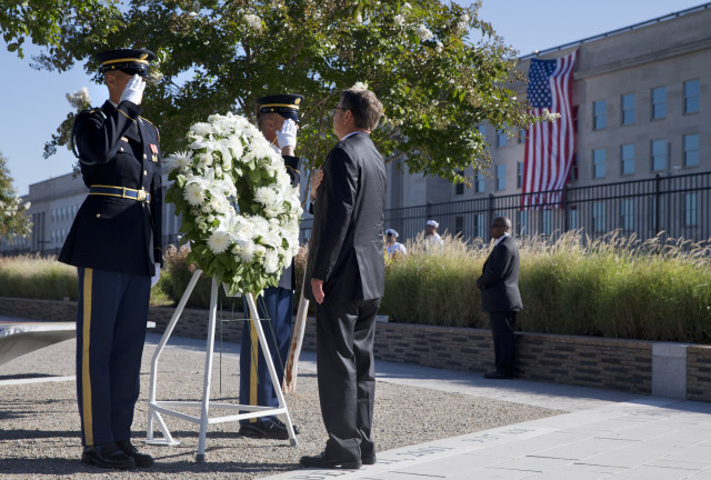 Defense Secretary Ash Carter attends a wreath ceremony during a memorial for the 14th anniversary of the September 11th attacks, Sept. 11, 2015, at the Pentagon.