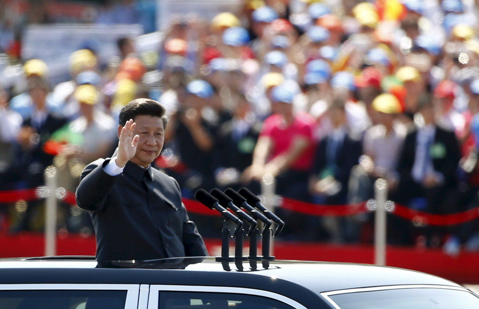 Chinese President Xi Jinping waves at the beginning of the military parade marking the 70th anniversary of the end of World War II in Beijing on Sept. 3, 2015. (Reuters)