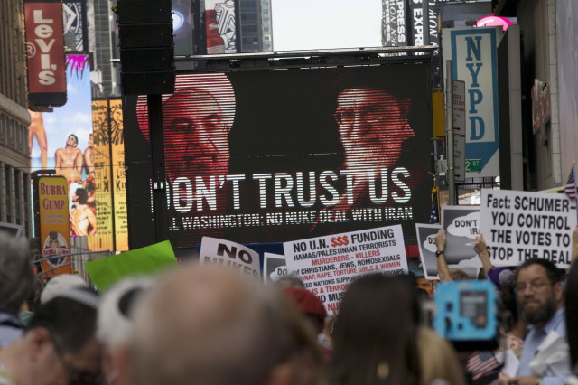 An image of Iranian leaders is projected on a giant screen  during a rally apposing the nuclear deal with Iran in New York's Times Square, July 22, 2015. (Reuters)