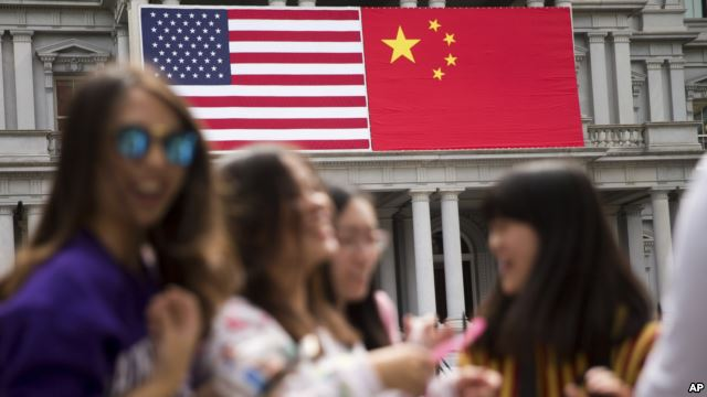 The American and Chinese flags fly in Beijing, China. (AP/file)