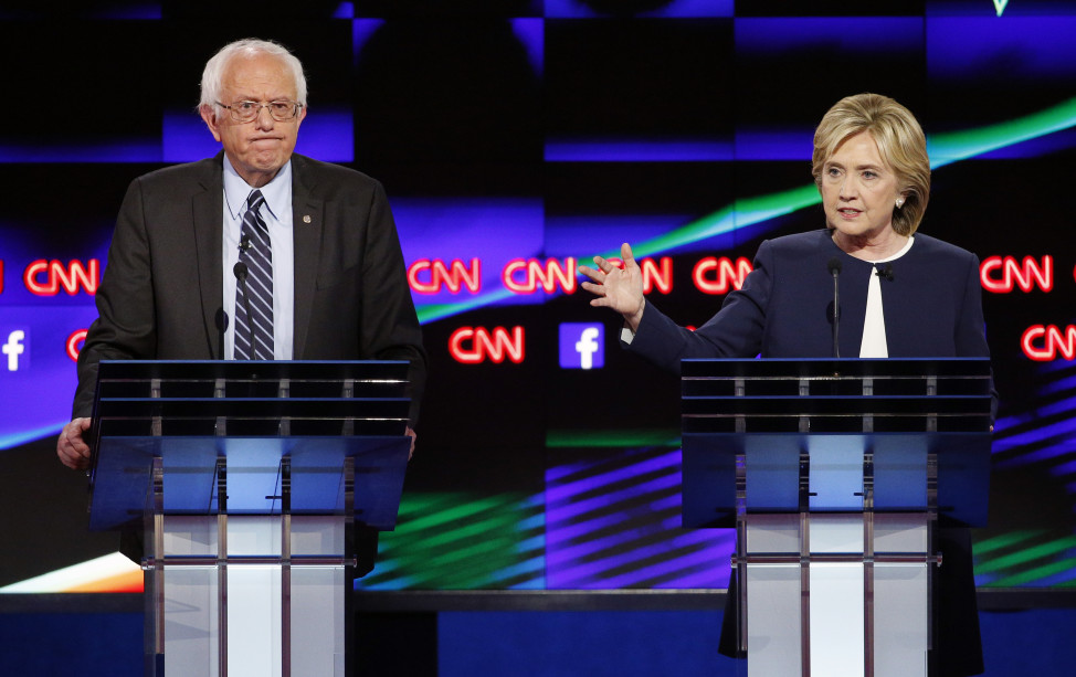Hillary Rodham Clinton, right, speaks as Sen. Bernie Sanders, I-Vt., listens during the CNN Democratic presidential debate Tuesday, Oct. 13, 2015, in Las Vegas.(AP)