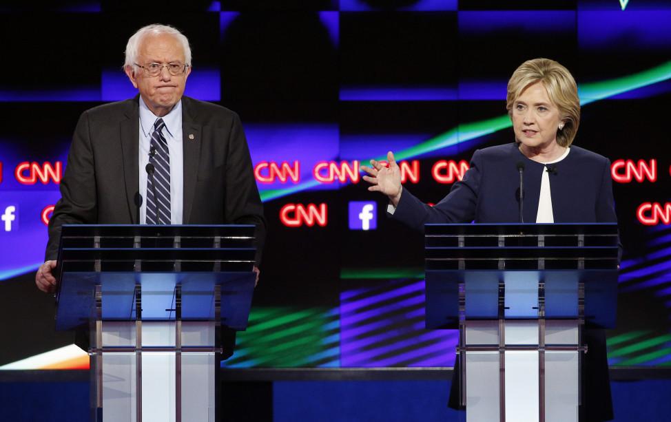 Hillary Rodham Clinton, right, speaks as Sen. Bernie Sanders, I-Vt., listens during the CNN Democratic presidential debate Tuesday, Oct. 13, 2015, in Las Vegas.(AP)