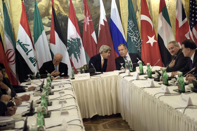 UN Special Envoy for Syria Staffan de Mistura, left, US Secretary of State John Kerry, second left, and Russian Foreign Minister Sergey Lavrov, third right, meet with foreign ministers for talks on Syria in Vienna on Oct. 30, 2015. (AP)