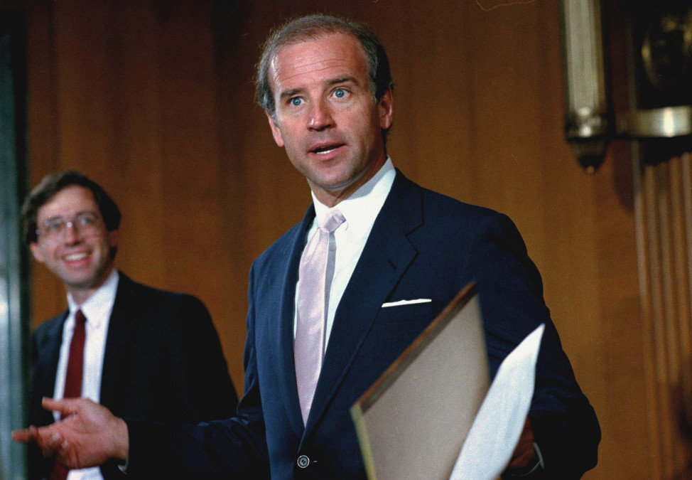 Sen. Joe Biden (D-Del.) takes a break from the  confirmation hearings for Supreme Court justice nominee Antonin Scalia on Aug. 7, 1986. (AP)