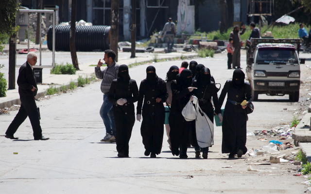 Female medical nurse activists tour the streets of Aleppo's rebel-controlled areas during a polio vaccine campaign. April 13, 2015. (REUTERS)