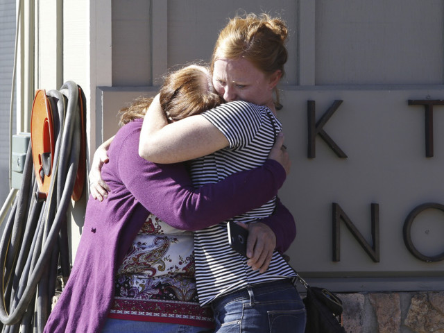 Donice Smith (L) is embraced after one of her former teachers was killed in a mass shooting at Umpqua Community College in Oregon on Oct. 1, 2015.