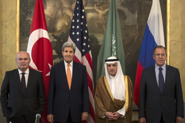 Turkish Foreign Minister Feridun Sinirlioglu (L), U.S. Secretary of State John Kerry (2nd L), Saudi Foreign Minister Adel al-Jubeir (3rd L) and Russian Foreign Minister Sergey Lavrov pose during a photo opportunity before a meeting in Vienna, October 23, 2015. (REUTERS)