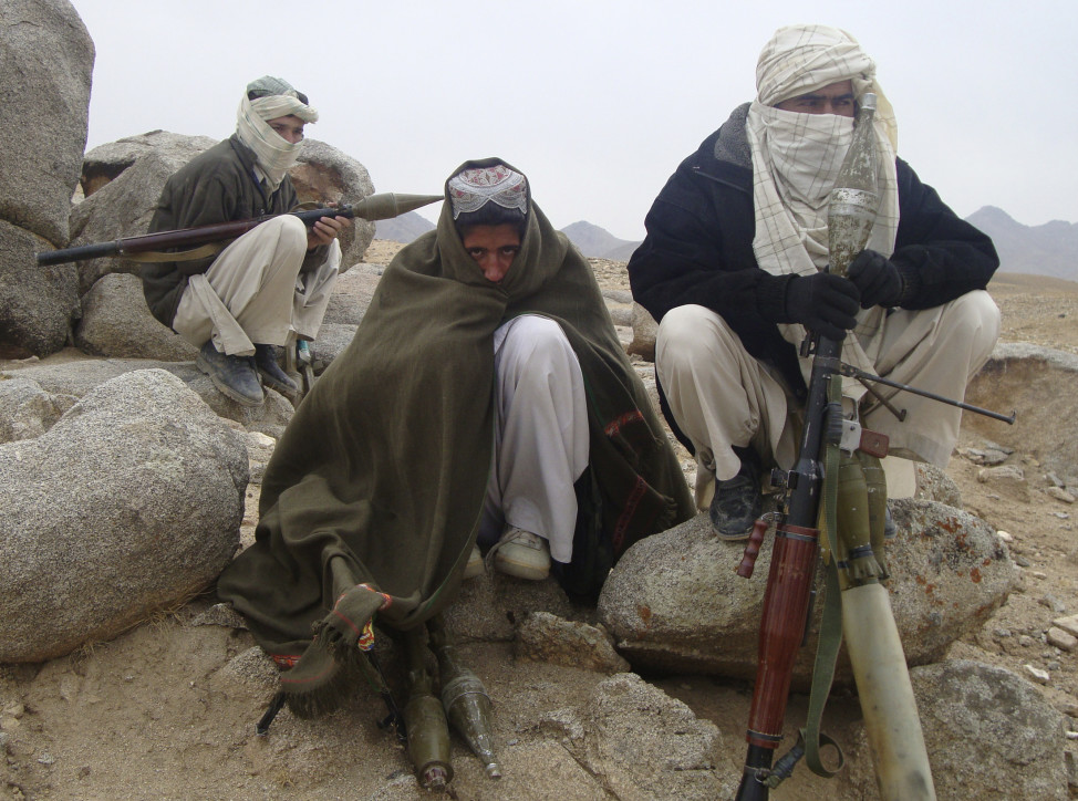 Taliban fighters pose with weapons in an undisclosed location in Afghanistan on Oct. 30, 2009. (Reuters)
