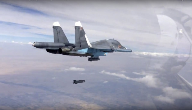 Russian Su-34 strike fighter drops a bomb over Syria October 9, 2015. (Russian Defense Ministry Press Service via AP)