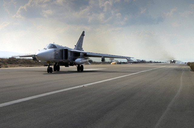 A Russian SU-24M jet fighter prepares to take off from an airbase Hmeimim in Syria on October 6, 2015. A spokeswoman for the Russian foreign ministry has rejected claims that Russia in its airstrikes in Syria is targeting civilians or opposition forces. (AP Photo/ Russian Defense Ministry Press Service)