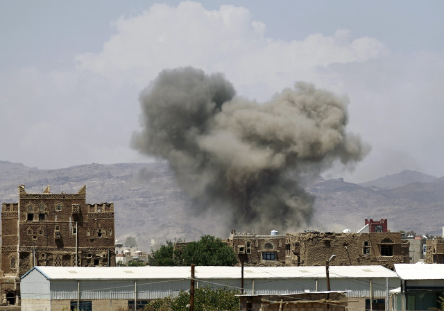 Smoke billows from buildings after reported air strikes by the Saudi-led coalition on arms warehouses at Al-Dailami air base, on September 29, 2015, north of the capital Sanaa. (AFP)