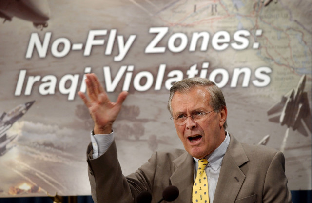 Defense Secretary Donald H. Rumsfeld criticizes Iraq for continuing to fire on U.S. and British warplanes patrolling over two no-fly zones at a Pentagon press briefing on Sept. 30, 2002. (AP/File)
