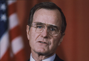 Vice President George Bush addresses a news conference at the American Embassy in London on Feb. 10, 1983. (AP/File).