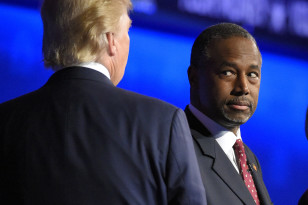 Ben Carson watches as Donald Trump takes the stage during the CNBC Republican presidential debate on Oct. 28, 2015 in Boulder, Colo. (AP)