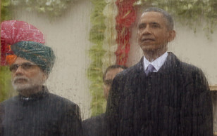India's Prime Minister Narendra Modi (L) and President Obama watch India's Republic Day parade behind rain- streaked bullet proof glass in New Delhi, India on  Jan. 26, 2015.(Reuters)