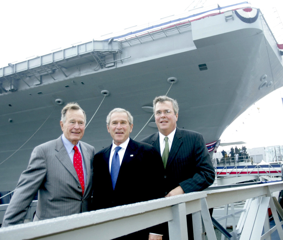 President Bush, center with former President George H.W. Bush and Florida Gov. Jeb  Bush, right, pose in front of the aircraft carrier George H.W. Bush after a christening ceremony in Newport News, Va. on Oct.. 7, 2006. (AP/File)