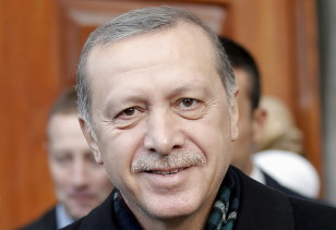 Turkish President Tayyip Erdogan smiles as he leaves a mosque in Istanbul on Nov. 2, 2015.