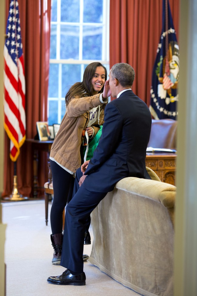 "Feb. 23, 2015 ""The President's daughter Malia stopped by the Oval Office one afternoon to see her dad and, while they were talking, she wiped something from his face."" (Official White House Photo by Pete Souza)"