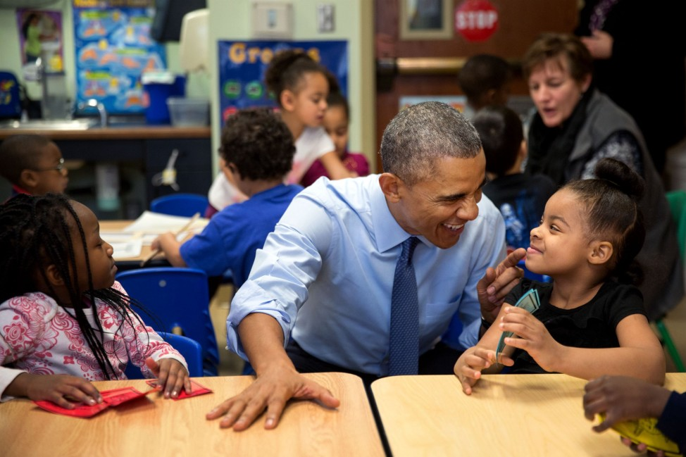 "Jan. 22, 2015 ""While we were in Lawrence, Kan., we stopped at the Community Children's Center–one of the nation's oldest Head Start providers. The President sat next to Akira Cooper, right, and reacted to something she said to him."" (Official White House Photo by Pete Souza)"