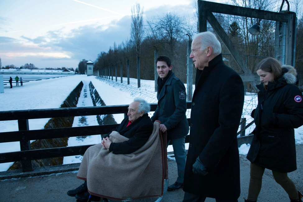 "Feb. 8, 2015 ""David Lienemann, the Vice President's photographer, made this image in Dachau, Germany, of the VP and his granddaughter Finnegan Biden touring the concentration camp with Max Mannheimer, a 95-year-old Holocaust survivor."" (Official White House Photo by David Lienemann)"