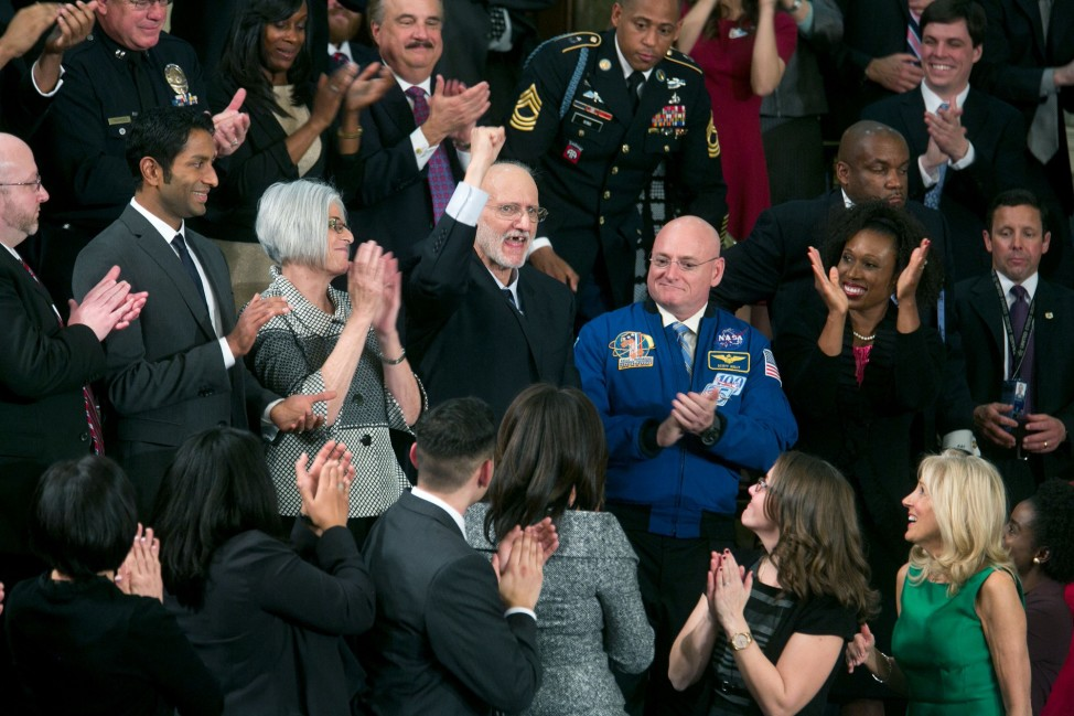 "Jan. 20, 2015 ""Recently released from prison in Cuba, Alan Gross pumps his fist in the air from First Lady Michelle Obama's box after President Obama acknowledged him at the State of the Union address at the U.S. Capitol."" (Official White House Photo By Chuck Kennedy)"