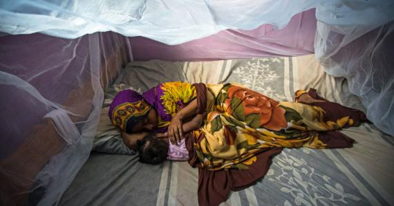 Habiba Suleiman, 29, a district malaria surveillance officer in Zanzibar, naps with her little girl Rahma under a mosquito net. She lives in Tanzania, where up to 80,000 people die from malaria each year. Hariba is working to change that. Read her story on USAID's storytelling hub. (photo courtesy of USAID)