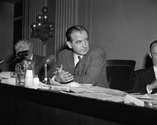 Sen. Joseph McCarthy, R-Wisc., right, at a seated session of the joint Congressional Committee on Housing on Jan. 28, 1948. (AP)