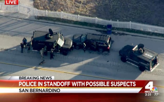 Armored vehicles surround an SUV following tje mass shooting in San Bernardino, Ca. that killed 14 people on  Dec. 2, 2015. (AP)