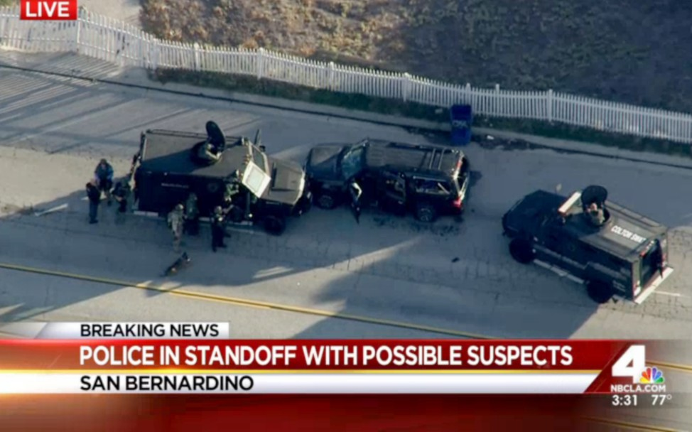 Armored vehicles surround an SUV following the mass shooting in San Bernardino, Calif., on Dec. 2, 2015. (AP)