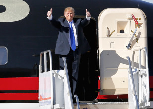 Republican presidential candidate Donald Trump gives as thumbs-up as he arrives for a campaign rally, Dec. 16, 2015, in Mesa, Arizona. (AP)
