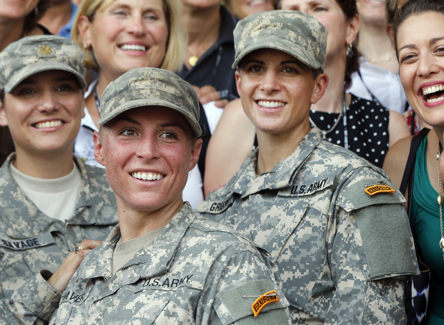 U.S. Army First Lt. Shaye Haver, center, and Capt. Kristen Griest, right, pose with other female West Point alumni after becoming the first women to graduate from Army Ranger school. Aug. 21, 2015, at Fort Benning, Ga. (AP)