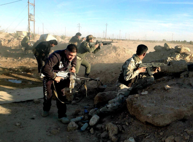 Iraqi security forces take combat positions on the front line with Islamic State group militants in Ramadi, capital of Iraq's Anbar province, 70 miles (115 kilometers) west of Baghdad, Thursday, Dec. 10, 2015. (AP)