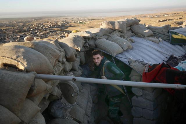A Kurdish peshmerga fighter pauses during an operation to retake the northern Iraqi town of Sinjar on Thursday, Nov. 12, 2015 (AP)