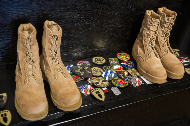 Patches left by U.S. and other ISAF member country soldiers are seen on a step after a memorial for Specialist Wyatt Martin and Sergeant First Class Ramon Morris at Bagram Air Field in the Parwan province of Afghanistan December 23, 2014. Specialist Martin and Sergeant First Class Ramon were killed on December 12th by an improvised explosive device while on patrol near Bagram Air Field. Picture taken  December 23, 2014.  (REUTERS