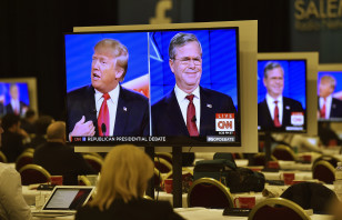 Republican presidential candidates Donald Trump (L) and  former Governor Jeb Bush (R) are seen debating on video monitors during the Republican presidential debate in Las Vegas on Dec. 15, 2015. (Reuters)