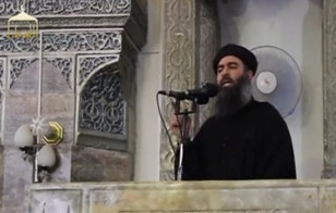 Islamic State leader Abu Bakr al-Baghdadi makes his first public appearance at a mosque in the center of Iraq's second city, Mosul, according to a video posted on the Internet on July 5, 2014. (Reuters)