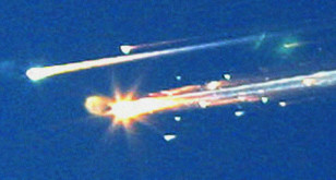 Debris from the space shuttle Columbia streaks across the sky over Tyler, Texas on Feb. 1, 2003. (AP file photo)