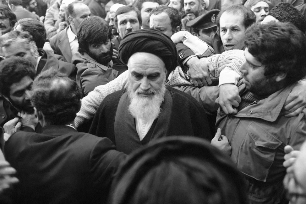 Ayatollah Khomeini is surrounded by supporters after delivering a speech at the airport in Tehran  on Feb. 1, 1979, the day of his return from 14 years of exile. (AP)